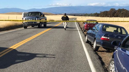 Crime tape blocks off Rancho Tehama Road leading into the Rancho Tehama subdivision in northern California. (AAP)