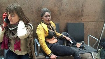 This image of Nidhi Chaphekar in the moments after the bombing went viral. (AAP)