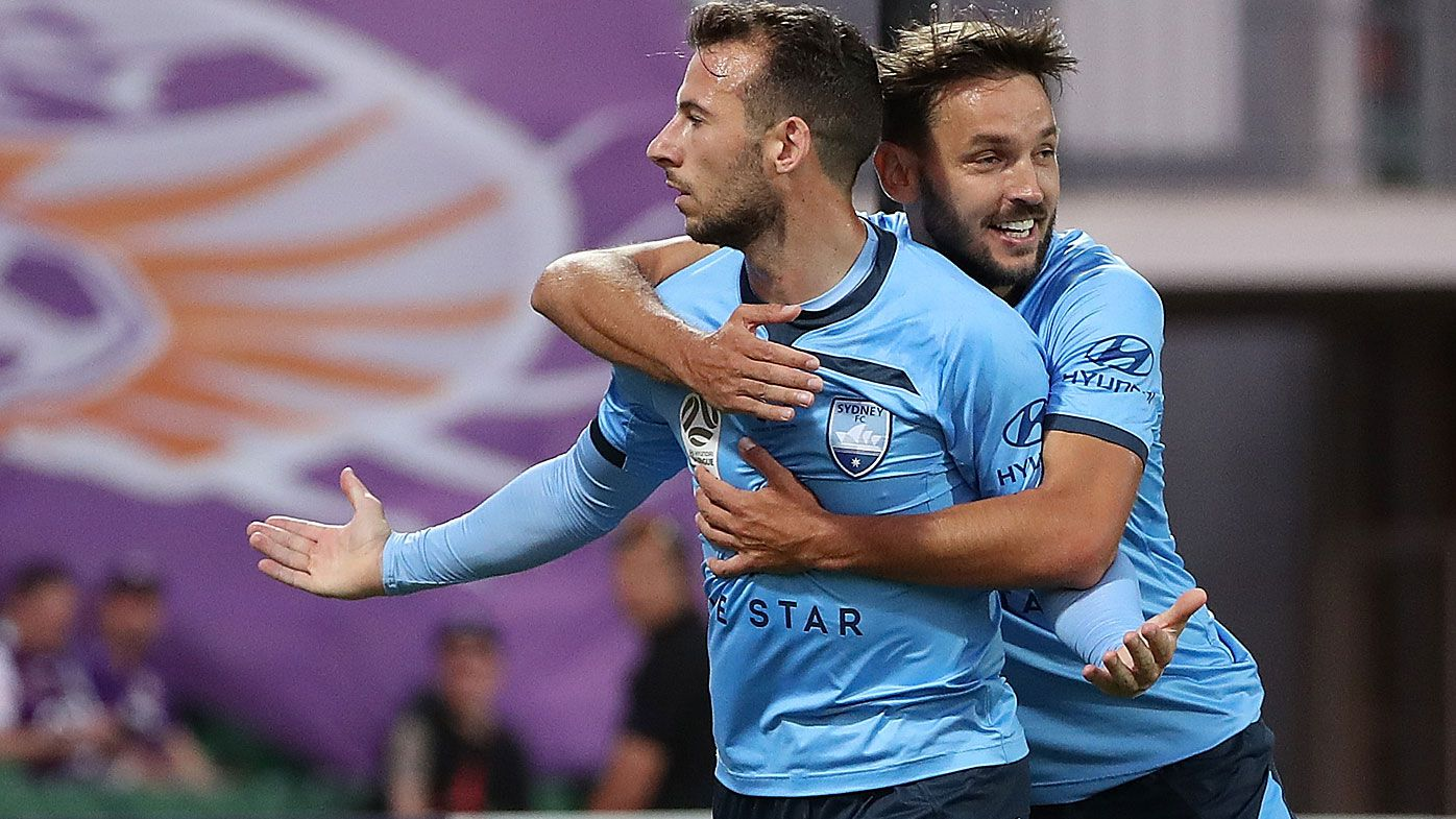 Adam Le Fondre and Milos Ninkovic of Sydney celebrate a goal