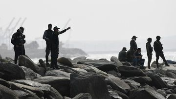Security forces guard the shore where authorities claim a group of armed men landed in the port city of La Guaira, Venezuela