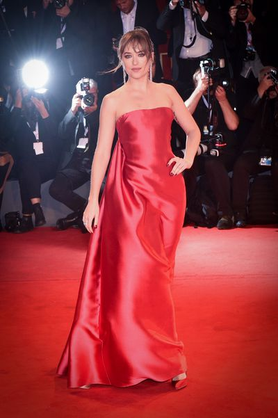 "<p>It's known as the city of romance but during the <a href=""https://style.nine.com.au/2016/09/05/15/24/venice-top-10-looks-film-red-carpet"" target=""_blank"" title=""Venice Film Festival"" draggable=""false"">Venice Film Festival</a> it becomes the city of legs, sheer fabrics and pink and red frocks.</p> <p>The Italian red carpet has been inundated with rouge and scarlet looks that make it resemble a Valentine's pop-up store, but among the sea of vivid hues there have been a number of style standouts.</p> <p>Over the weekend, Dakota Johnson arrived to promote her upcoming film <em>Suspira</em> and showed off not one, but two, jaw-dropping looks.</p> <p>But in what may be the 28 year-old's real standout moment, the <em>Fifty Shades</em> embodied all things 'Old Hollywood' as she matched the <a href=""https://style.nine.com.au/2018/08/27/14/18/style-fashhion-red-carpet-iheart-radio-awards"" target=""_blank"" title=""red carpet"" draggable=""false"">red carpet</a> in a  strapless silk Christian Dior Haute Couture dress. Johnson paired the gown with red Jimmy Choo heels and Messika Paris jewelry.</p> <p>Earlier in the day, the actress arrived by boat pulling out all the stops in a white strapless lace gown, also by Dior.</p> <p>Johnson isn't the only A-lister to turn heads on the red carpet.</p> <p>Here are our favourite looks from the 2018 Venice Film Festival. </p>"