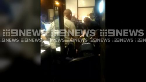 The man allegedly responsible for the flooding barricaded himself in an office before he was arrested. Picture: 9NEWS.