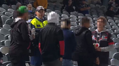 Police speak with the fans accused of making the racist comments.