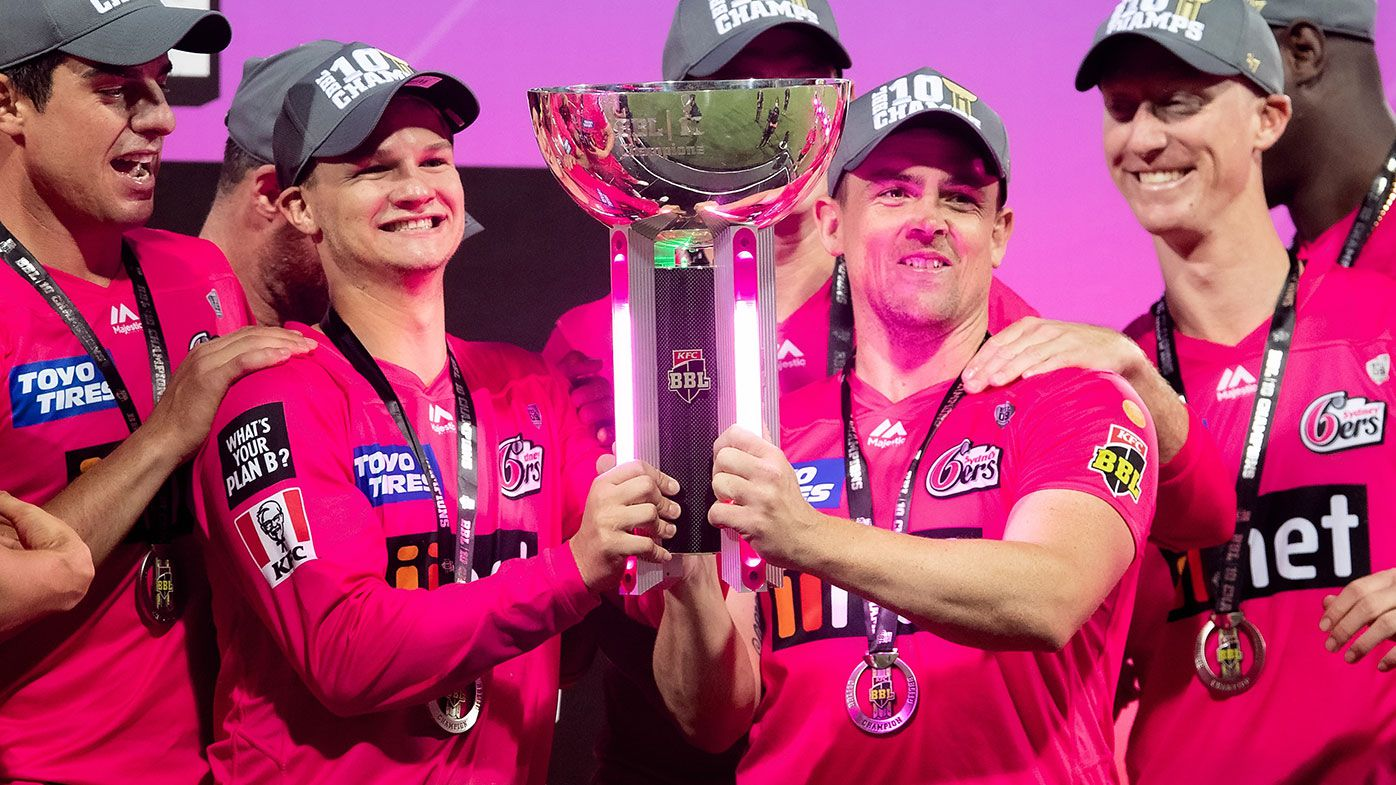 Sydney Sixers players celebrate their win in BBL10.