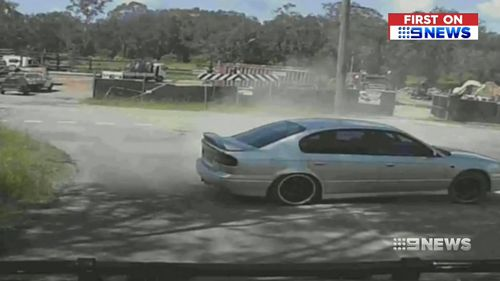 The hoon driver managed to veer off and pull to a stop just metres from Luke Taylor's oncoming car. (9NEWS)