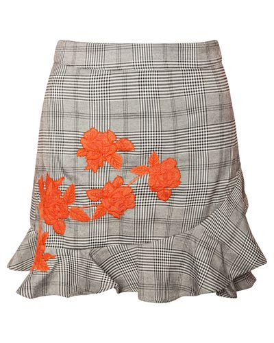 """<a href=""""https://www.missguidedau.com/"""" target=""""_blank"""">Grey Floral Embroidered Checked Frill Mini Skirt, $50.59.</a>"""