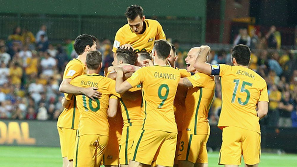 Socceroos players celebrate a goal against Tajikistan.(Getty)