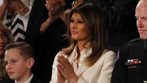 First Lady Melania Trump wore white to the president's address - a colour linked to the suffragette movement. (AAP)