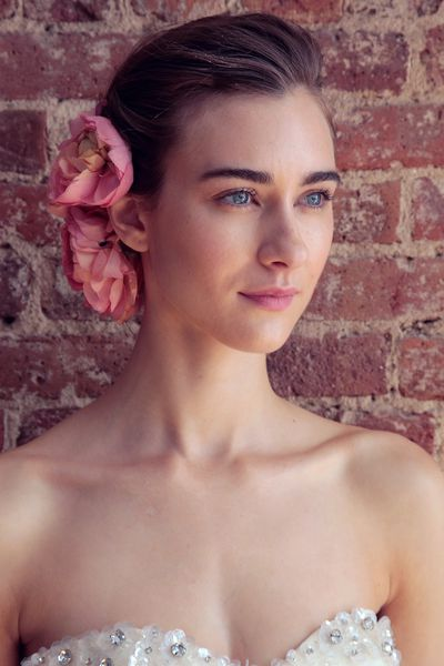 Forgo the earrings and necklace and opt for flowers instead. Here, the florals are complemented by loosely swept-back hair.