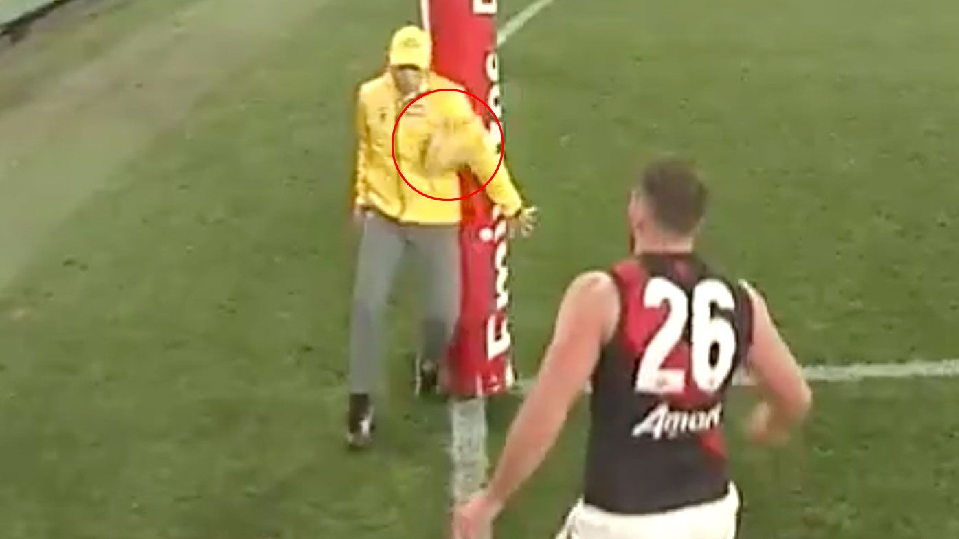 'No words': AFL goal umpire impedes ball in controversial review