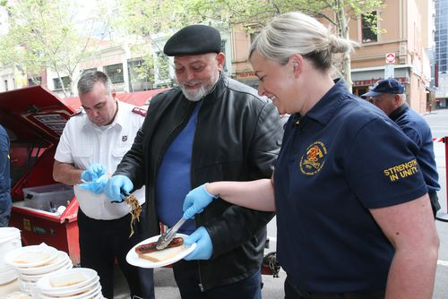 Mick Gatto (centre) is seen with Rachel Cowling from the United Firefighters association and Major Brendan Nottle from the Salvation Army at a fundraising launch in Melbourne, Thursday, October 10, 2019. The Salvation Army is calling for more accomodation for the homeless. (AAP Image/David Crosling) NO ARCHIVING