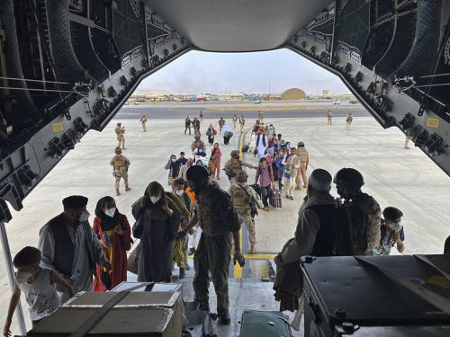 In this photo provided by the Spanish Defence Ministry and taken in Kabul, Afghanistan, people board a Spanish airforce A400 plane as part of an evacuation plan at Kabul airport in Afghanistan.