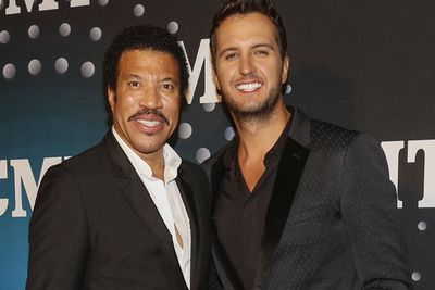 Lionel Richie and Luke Bryan suit up for the CMT awards red carpet.
