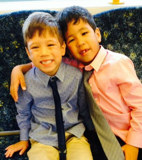 Josiah and Kaleb celebrate  the day that they were adopted after years in the foster care system. Picture: Supplied