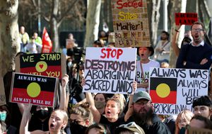 Hundreds protest at Rio Tinto's Perth office after mining giant blew up indigenous site