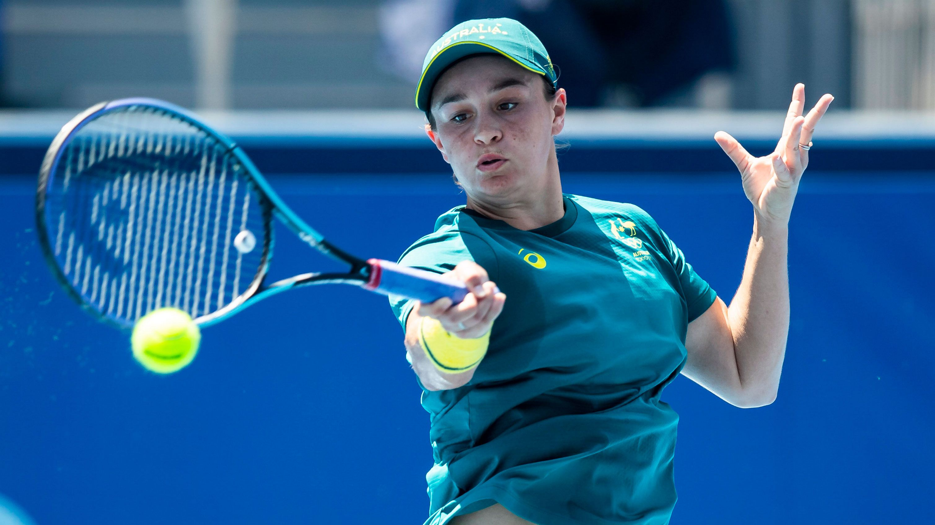 Ash Barty hits a forehand in Tokyo.