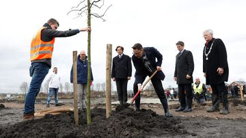 Dutch minister of Foreign affairs Bert Koenders (4nd L), Malaysia's Ambassador Ahmad Nazri Bin Yusof (C) and Tan Sri Mohamad Nor Yusof (3nd R), chairman of Malaysia Airlines, plant trees for the national monument in memory of the victims of the flight MH17 in Vijfhuizen on March 18, 2017. (AFP)