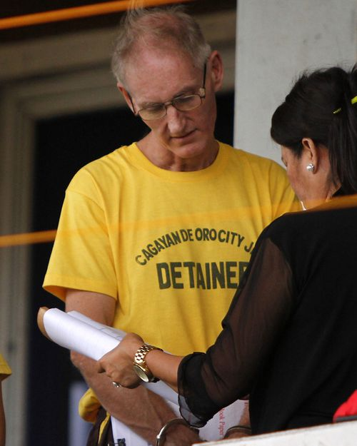 Gerard Peter Scully of Australia (L), an alleged kingpin of a child porn cyber den in the Philippines. Source: AFP
