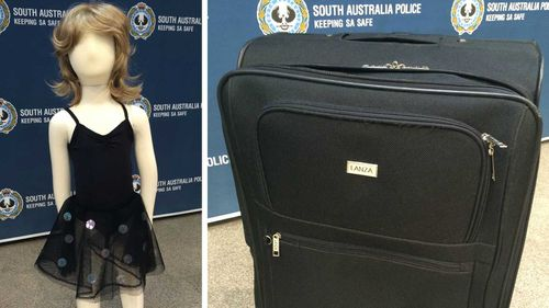 A black dress and suitcase similar to those found by the Karoonda Highway on July 15. (SA Police)