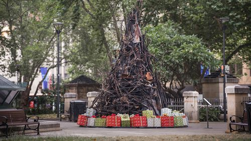 A burnt Christmas tree has been erected in the heart of Sydney.