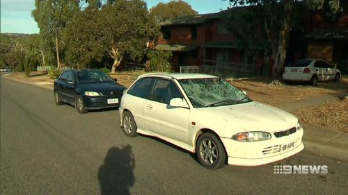 Cars were damaged and a man was bashed during the violence. (9NEWS)