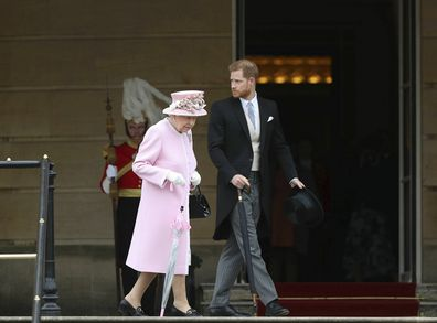 Queen walking with Prince Harry