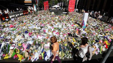 Flowers laid in memorial to the victims of the Lindt cafe siege. (AAP)