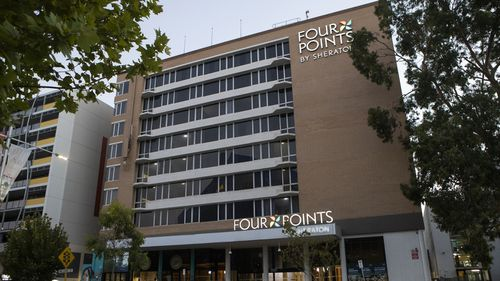 A security guard who contracted COVID-19 at the Four Points by Sheraton hotel was not wearing a mask.