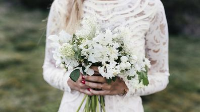 Bride with wedding dress and flowers