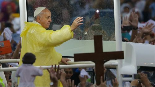 """Pope Francis in a Filipino-inspired """"popemobile"""". (AAP)"""
