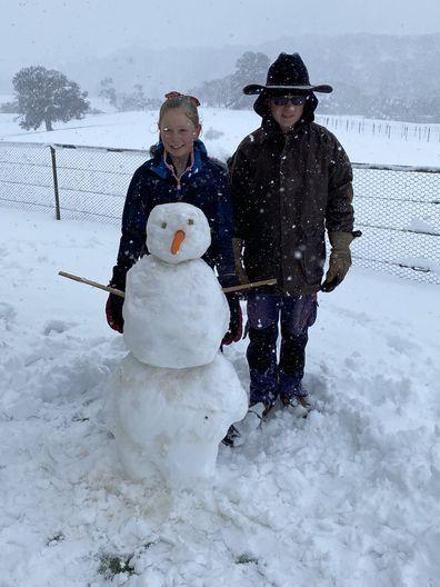 Lydia and Callum build a snowman