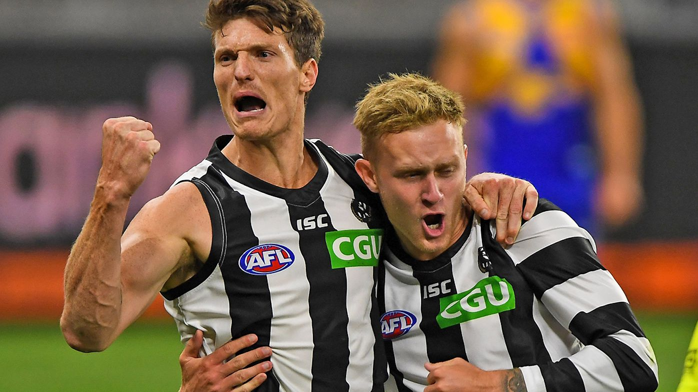 Brody Mihocek and Jaidyn Stephenson of the Magpies celebrates a goal late in the game