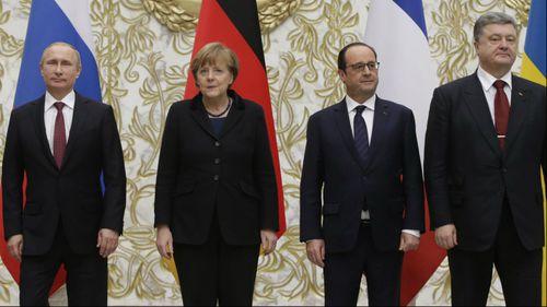 Vladimir Putin, Angela Merkel, Francois Hollande and Petro Poroshenko. (AAP)
