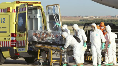 First Ebola victim arrives in Europe, as reports emerge of bodies dumped in streets