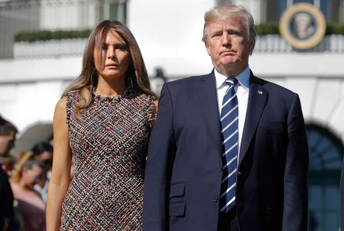 President Donald Trump and First Lady Melania stage a silent tribute to the victims shot from the 32nd floor of the the Mandalay Bay Casino.