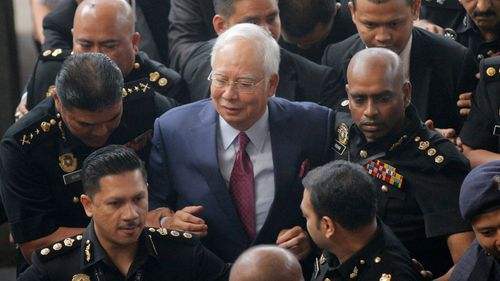Najib Razak has been charged with criminal breach of trust. (AAP)
