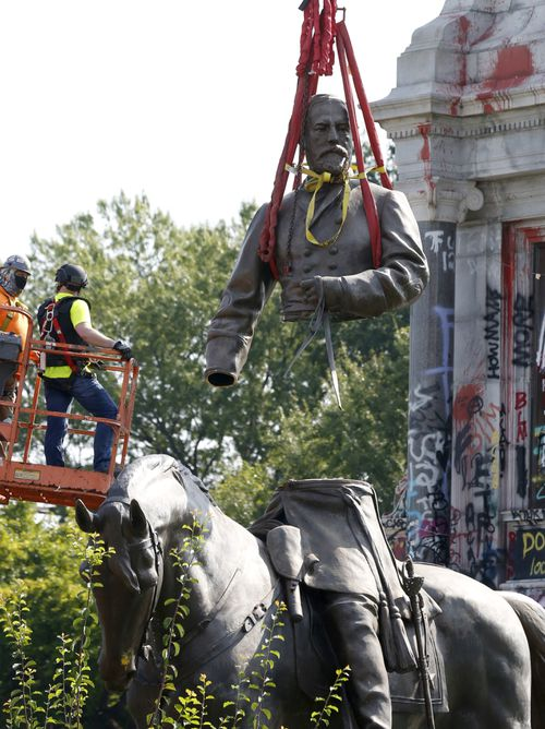 The top part of the General Robert E. Lee statue was lifted during its removal on Monument Avenue in Richmond, Virginia.