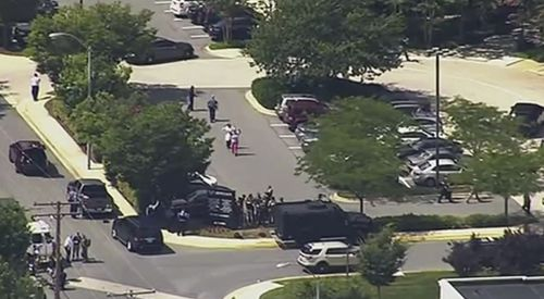 People were seen leaving the building walking in single file. Picture: AP