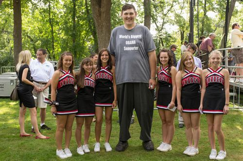 Igor Vovkovinskiy towers above a group of cheerleaders from the Cannon Falls High School in Cannon Falls, Minnesota.