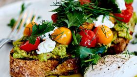Smashed avocado with cherry tomato, persian feta and poached egg recipe