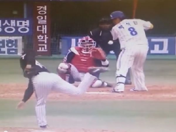 Baseball pitcher unleashes amazing curve ball