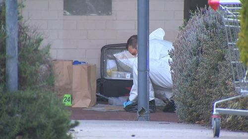 Forensic officers are searching for clues into the death.