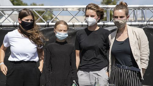 German climate activist Luisa Neubauer (L-R), Swedish climate activist Greta Thunberg, Belgian climate activist Anuna De Wever and Belgian climate activist Adelaide Charlier pose for a group picture after a press conference following the meeting with German Chancellor Angela Merkel on August 20, 2020 in Berlin, Germany