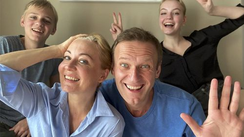 Russian opposition activist Alexei Navalny, foreground right, his wife Yulia, foreground left, his daughter Daria, right, and son Zakhar pose for a selfie.