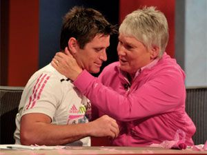 Shane Crawford with breast cancer survivor, Olympian Raelene Boyle, after his charity run in 2010.