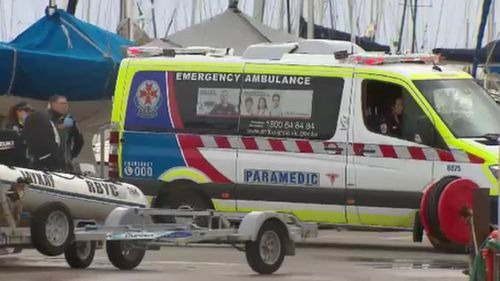 The man, who is yet to be identified, could not be revived after falling from the yacht. (9NEWS)