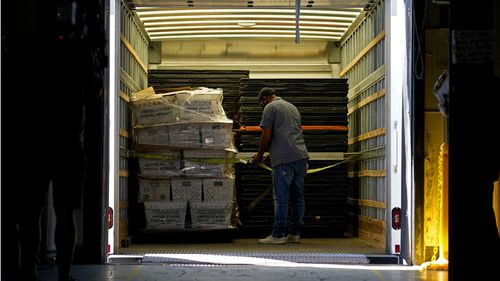 Absentee ballots are loaded onto a truck for mailing at the Wake County Board of Elections as preparation for the upcoming election are ongoing in Raleigh, North Carolina.
