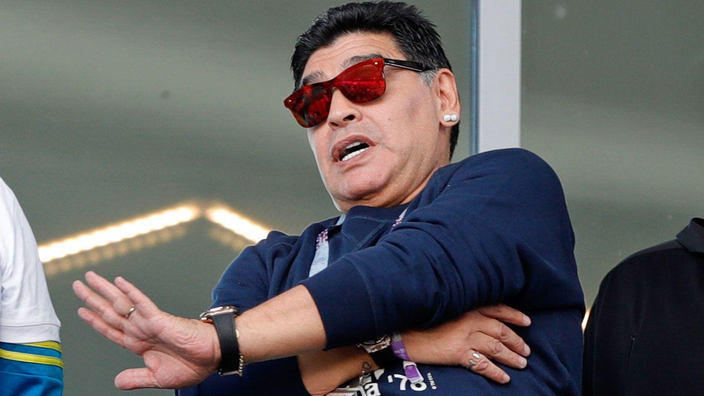 Diego Maradona denies making racist gesture during Argentina World Cup match