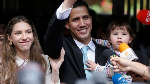 Opposition National Assembly President Juan Guaido, accompanied by his wife Fabiana Rosales and 20-month-old daughter Miranda