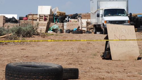 The father of a missing Georgia boy was training children at a New Mexico compound to commit school shootings, according to documents.